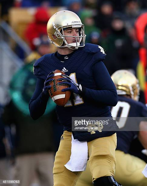 Tommy Rees of the Notre Dame Fighting Irish looks for a receiver against the Brigham Young Cougars at Notre Dame Stadium on November 23 2013 in South...