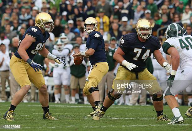 Tommy Rees of the Notre Dame Fighting Irish looks for a receiver against the Michigan State Spartans at Notre Dame Stadium on September 21 2013 in...