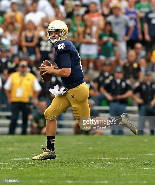 Tommy Rees of the Notre Dame Fighting Irish rolls out to look for a receiver against the Temple Owls at Notre Dame Stadium on August 31 2013 in South...