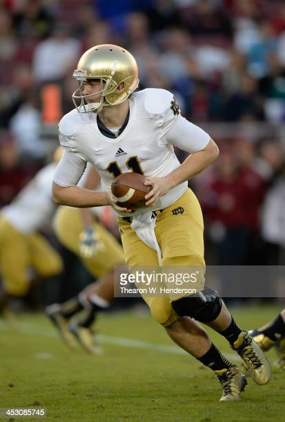 Tommy Rees of the Notre Dame Fighting Irish turns to hand the ball off to a running back against the Stanford Cardinal during the second quarter at...