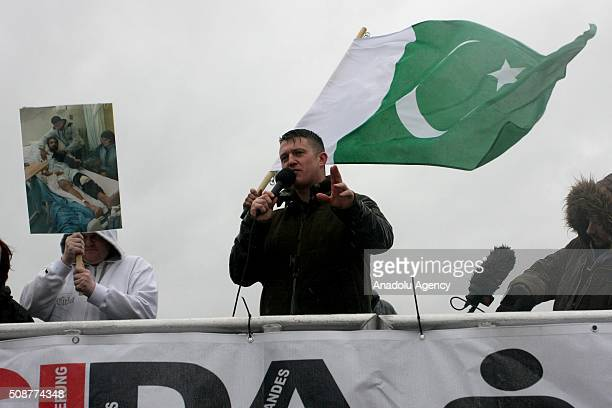 Tommy Robinson former founder of the English Defence League addresses the crowd during the 'silent march' organized by Pegida UK supporters in...