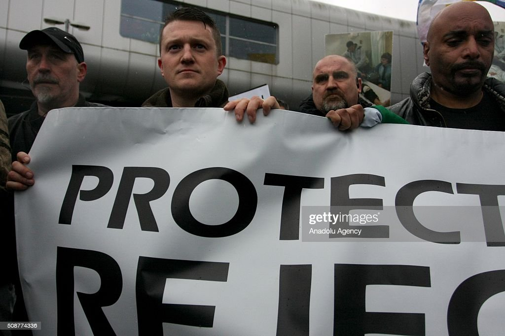 Tommy Robinson (L 2), former founder of the English Defence League, holds a banner during the 'silent march' organized by Pegida (Patriotic Europeans against the Islamisation of the West) UK supporters in Birmingham, England on February 6, 2016.