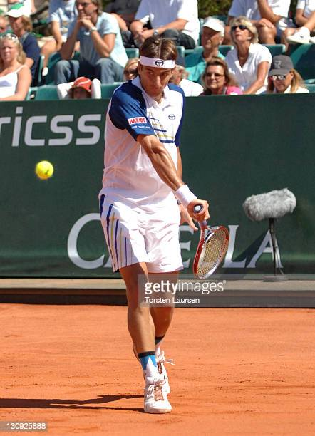 Tommy Robredo hits a return ro Nikolay Davydenko in the finals of the 2006 Swedish Open in Båstad Sweden July 16 2006 Robredo won 62 61