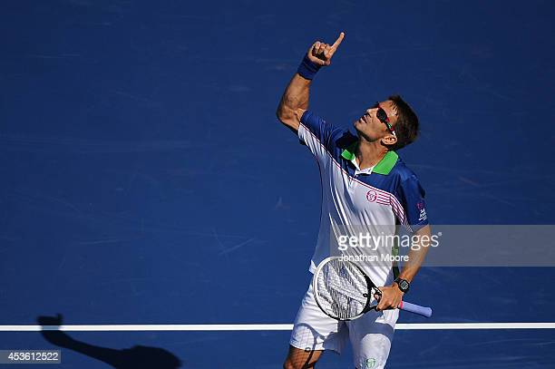 Tommy Robredo of Spain celebrates after defeating number one ranked Novak Djokovic of Serbia after a match on day 6 of the Western Southern Open at...