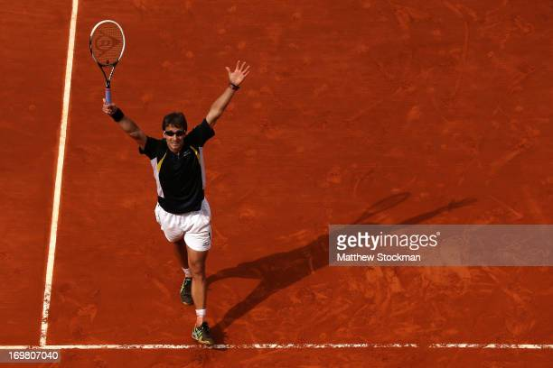 Tommy Robredo of Spain celebrates match point during his Men's Singles match against Nicolas Almargo of Spain during day eight of the French Open at...