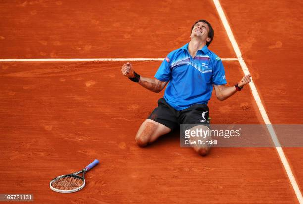 Tommy Robredo of Spain celebrates match point in his Men's Singles match against Gael Monfils of France during day six of the French Open at Roland...