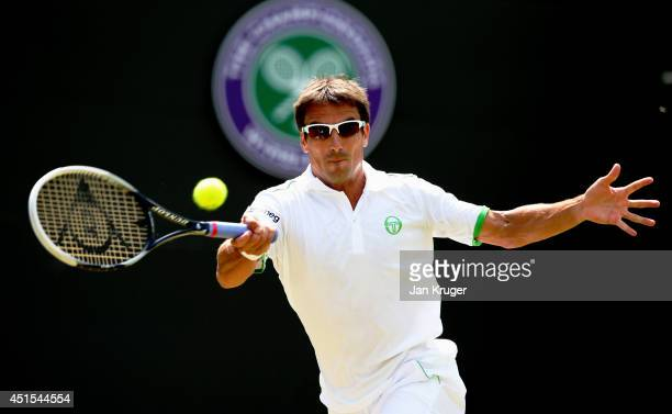 Tommy Robredo of Spain during his Gentlemen's Singles fourth round match against Roger Federer of Switzerland on day eight of the Wimbledon Lawn...