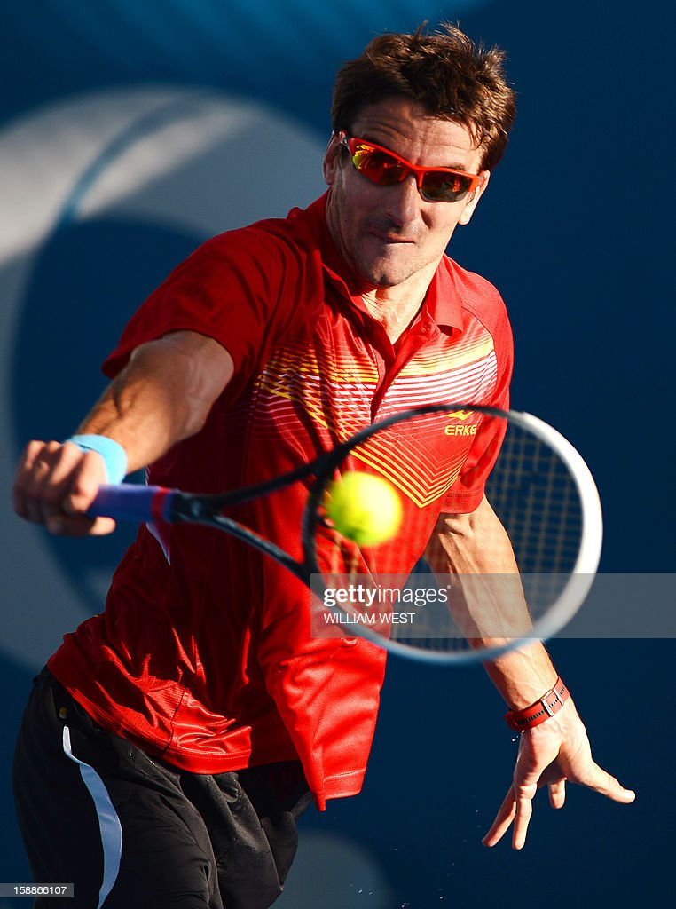Tommy Robredo of Spain hits a backhand return during his loss to Kei Nishikori of Japan in the second round at the Brisbane International tennis tournament on January 2, 2013. AFP PHOTO/William WEST USE