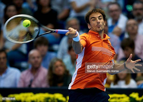 Tommy Robredo of Spain in action against Andy Murray of Great Britain in the final during day seven of the ATP 500 World Tour Valencia Open tennis...