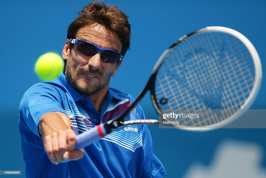 <a gi-track='captionPersonalityLinkClicked' href=/galleries/search?phrase=Tommy+Robredo&family=editorial&specificpeople=171958 ng-click='$event.stopPropagation()'>Tommy Robredo</a> of Spain plays a backhand in his first round match against John Millman of Australia during day three of Sydney International at Sydney Olympic Park Tennis Centre on January 8, 2013 in Sydney, Australia.
