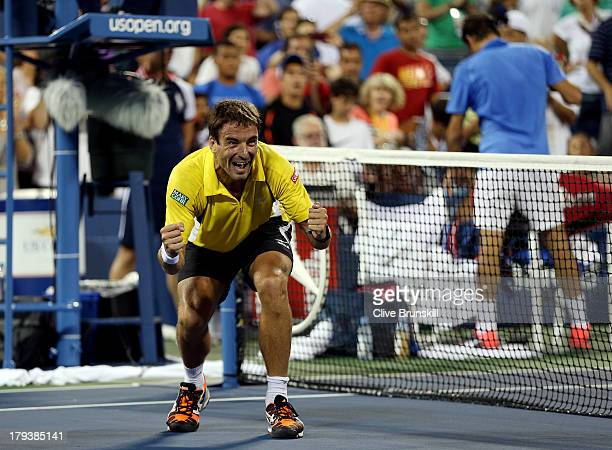 Tommy Robredo of Spain reacts after defeating Roger Federer of Switzerland in their fourth round men's singles match on Day Eight of the 2013 US Open...