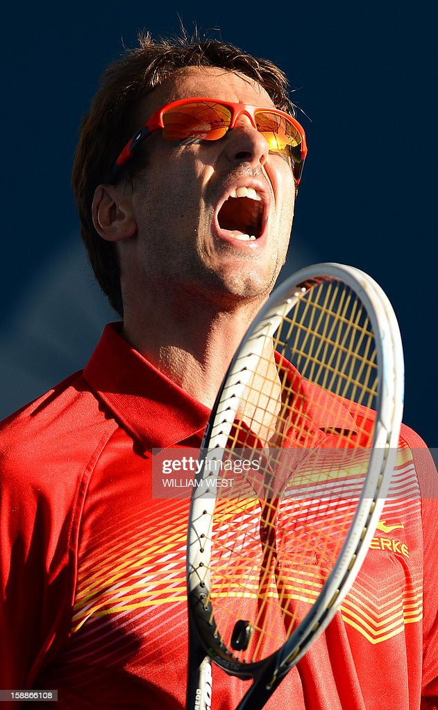 Tommy Robredo of Spain reacts during his loss to Kei Nishikori of Japan in the second round at the Brisbane International tennis tournament on January 2, 2013. AFP PHOTO/William WEST USE