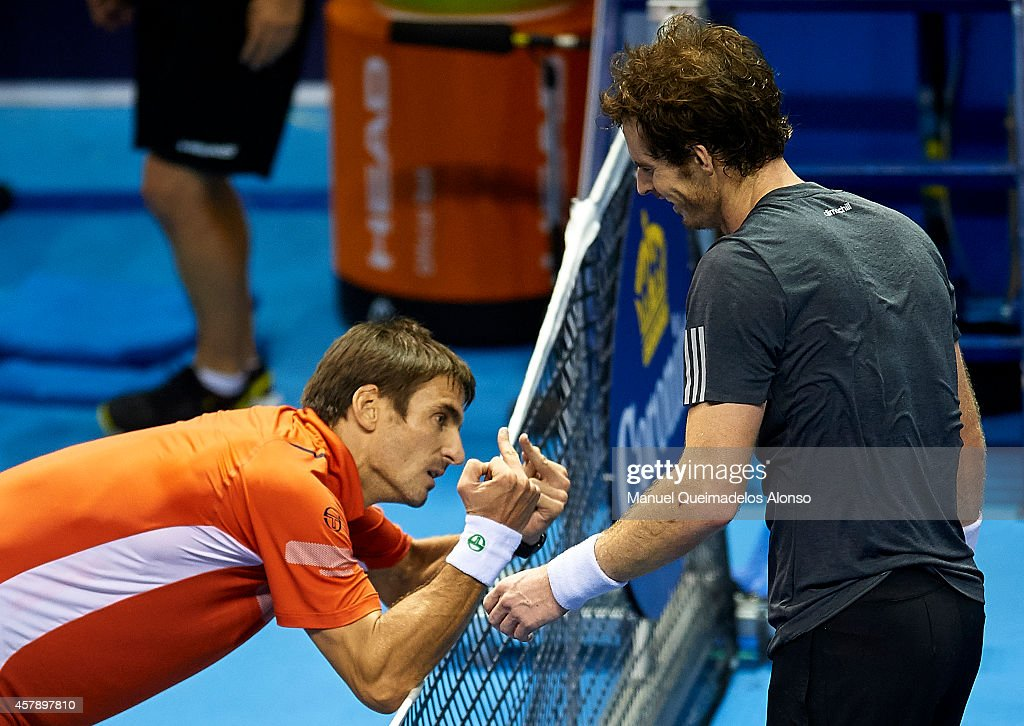 <a gi-track='captionPersonalityLinkClicked' href=/galleries/search?phrase=Tommy+Robredo&family=editorial&specificpeople=171958 ng-click='$event.stopPropagation()'>Tommy Robredo</a> of Spain reacts to Andy Murray of Great Britain in the final at the end of the match on day seven of the ATP 500 World Tour Valencia Open tennis tournament at the Ciudad de las Artes y las Ciencias on October 26, 2014 in Valencia, Spain.