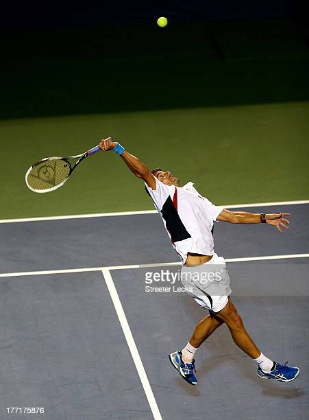Tommy Robredo of Spain returns a shot against Gael Monfils of France during day 4 of the WinstonSalem Open at Wake Forest University on August 21...