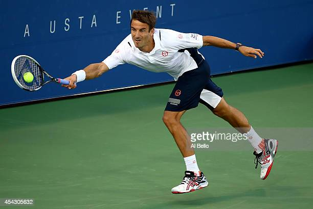 Tommy Robredo of Spain returns a shot against Simone Bolelli of Italy during their men's singles second round match on Day Four of the 2014 US Open...