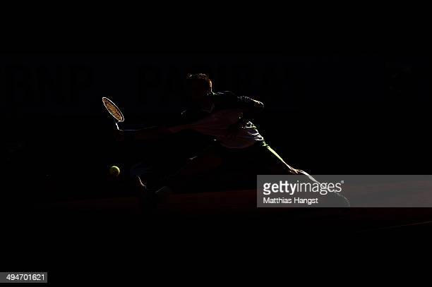 Tommy Robredo of Spain returns a shot during his men's singles match against John Isner of the United States on day six of the French Open at Roland...