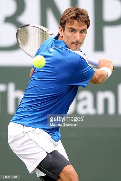 Tommy Robredo of Spain returns a shot to Sam Querrey during the BNP Paribas Open at the Indian Wells Tennis Garden on March 16 2011 in Indian Wells...