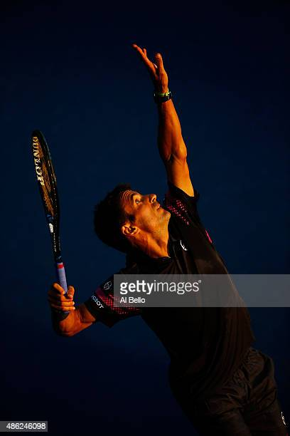 Tommy Robredo of Spain serves against Sam Groth of Australia during their Men's Singles Second Round match against on Day Three of the 2015 US Open...