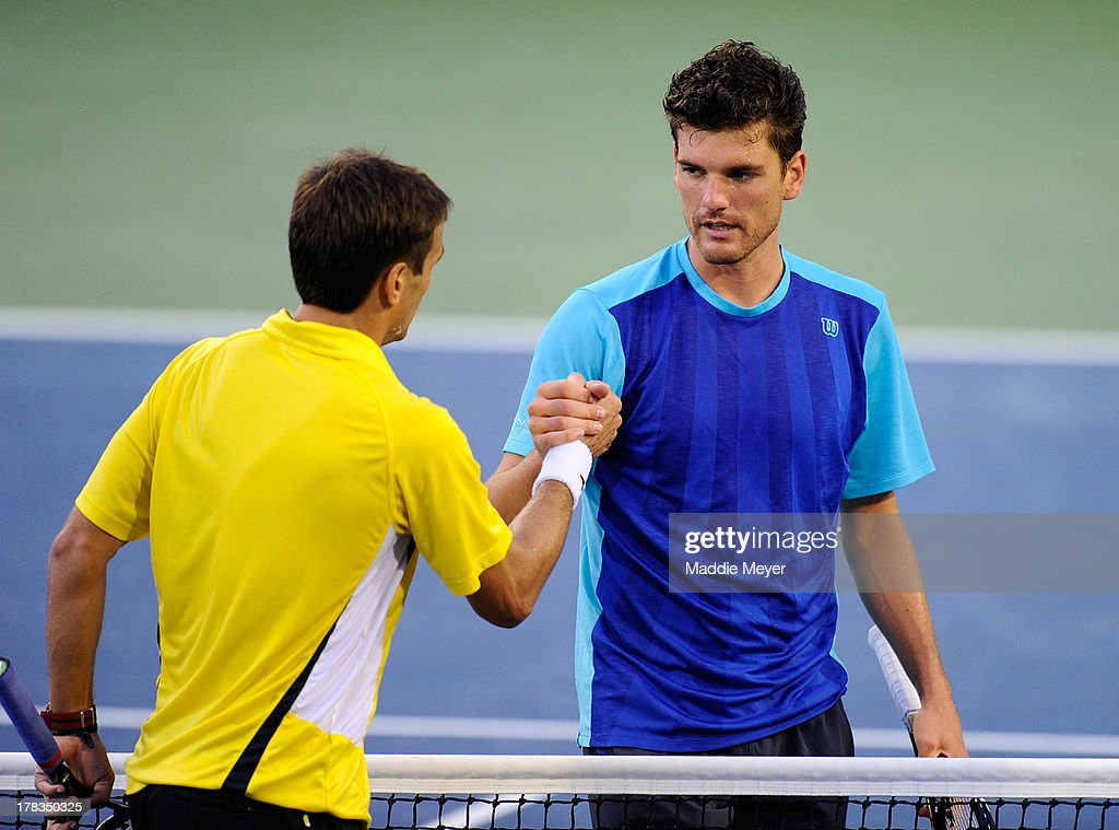 <a gi-track='captionPersonalityLinkClicked' href=/galleries/search?phrase=Tommy+Robredo&family=editorial&specificpeople=171958 ng-click='$event.stopPropagation()'>Tommy Robredo</a> of Spain shakes hands at the net with <a gi-track='captionPersonalityLinkClicked' href=/galleries/search?phrase=Frank+Dancevic&family=editorial&specificpeople=580662 ng-click='$event.stopPropagation()'>Frank Dancevic</a> of Canada after their men's singles second round match during their second round match on Day Four of the 2013 US Open at USTA Billie Jean King National Tennis Center on August 29, 2013 in the Flushing neighborhood of the Queens borough of New York City.