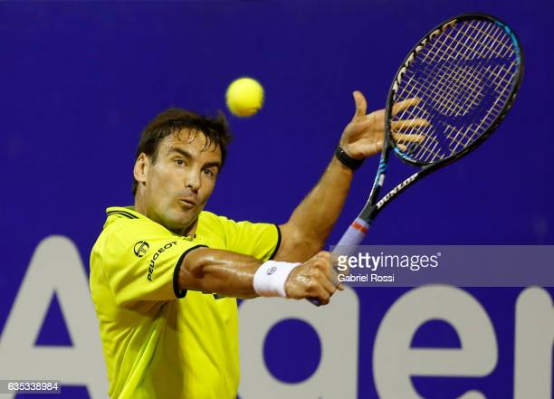 Tommy Robredo of Spain takes a backhand shot during a first round match between Tommy Robredo of Spain and Fabio Fognini of Italy as part of ATP...