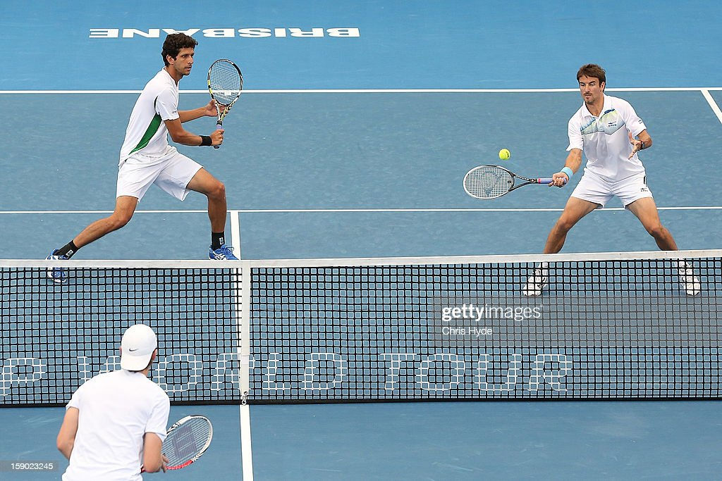 Tommy Robredo plays a forehand during his doubles final match partnered with Marcelo Melo against Eric Butorac and Paul Hanley on day eight of the Brisbane International at Pat Rafter Arena on January 6, 2013 in Brisbane, Australia.