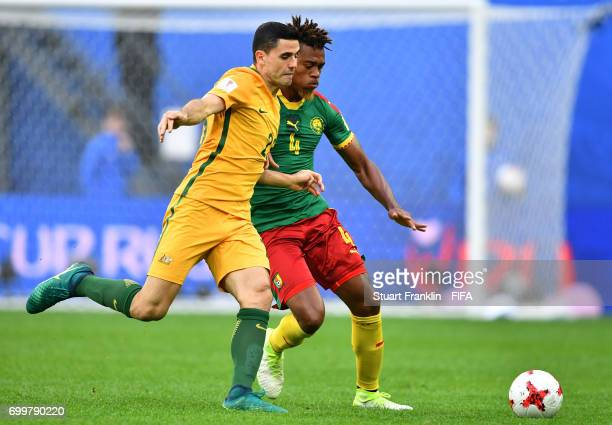 Tommy Rogic of Australia and Adolphe Teikeu of Cameroon battle for possession during the FIFA Confederations Cup Russia 2017 Group B match between...