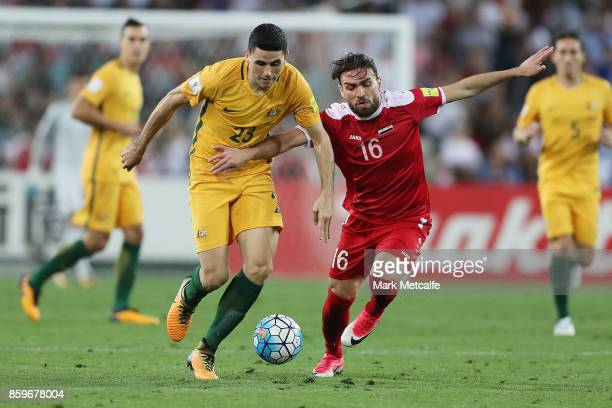 Tommy Rogic of Australia and Hamid Mido of Syria compete for the ball during the 2018 FIFA World Cup Asian Playoff match between the Australian...