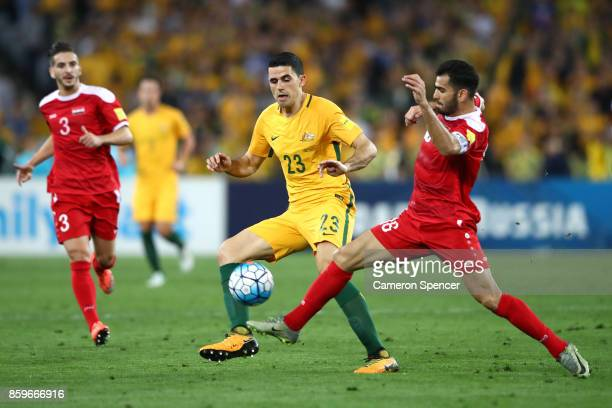 Tommy Rogic of Australia and Hamid Mido of Syria contest the ball during the 2018 FIFA World Cup Asian Playoff match between the Australian Socceroos...