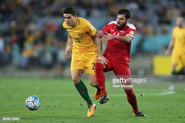 Tommy Rogic of Australia and Tamer Mohamd of Syria compete during the 2018 FIFA World Cup Asian Playoff match between the Australian Socceroos and...