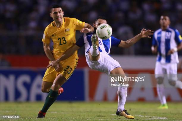Tommy Rogic of Australia struggles for the ball with Alfredo Mejia of Honduras during a first leg match between Honduras and Australia as part of...