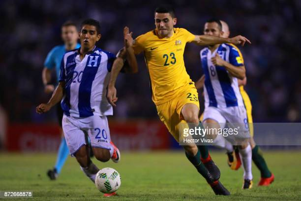 Tommy Rogic of Australia struggles for the ball with Jorge Carlos of Honduras during a first leg match between Honduras and Australia as part of FIFA...