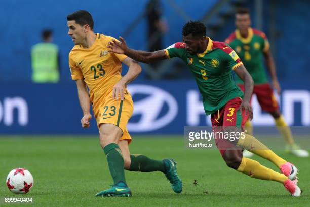 Tommy Rogic of the Australia national football team and AndreFrank Zambo Anguissa of the Cameroon national football team vie for the ball during the...