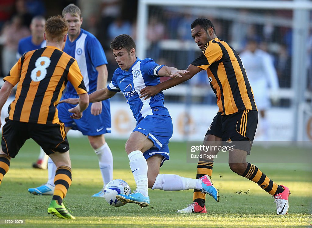 Tommy Rowe of Peterborough United controls the ball during the pre season friendly match between Peterborough United and Hull City at London Road Stadium on July 29, 2013 in Peterborough, England.