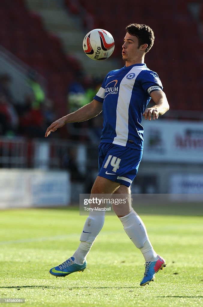 Tommy Rowe of Peterborough United during the Sky Bet League One match between Rotherham United and Peterborough United at The New York Stadium on September 28, 2013 in Rotherham, England.