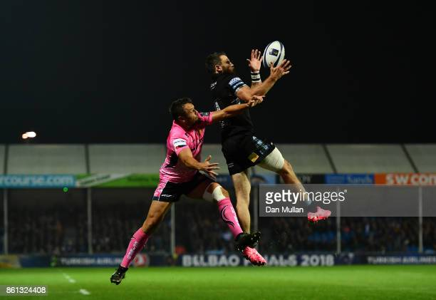 Tommy Seymour of Glasgow Warriors beats Phil Dollman of Exeter Chiefs in the air on way to scoring his side's first try during the European Rugby...
