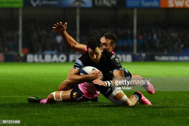 Tommy Seymour of Glasgow Warriors beats Phil Dollman of Exeter Chiefs to score his side's first try during the European Rugby Champions Cup Pool 3...