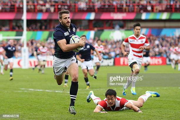 Tommy Seymour of Scotland goes over to score his teams third try during the 2015 Rugby World Cup Pool B match between Scotland and Japan at Kingsholm...