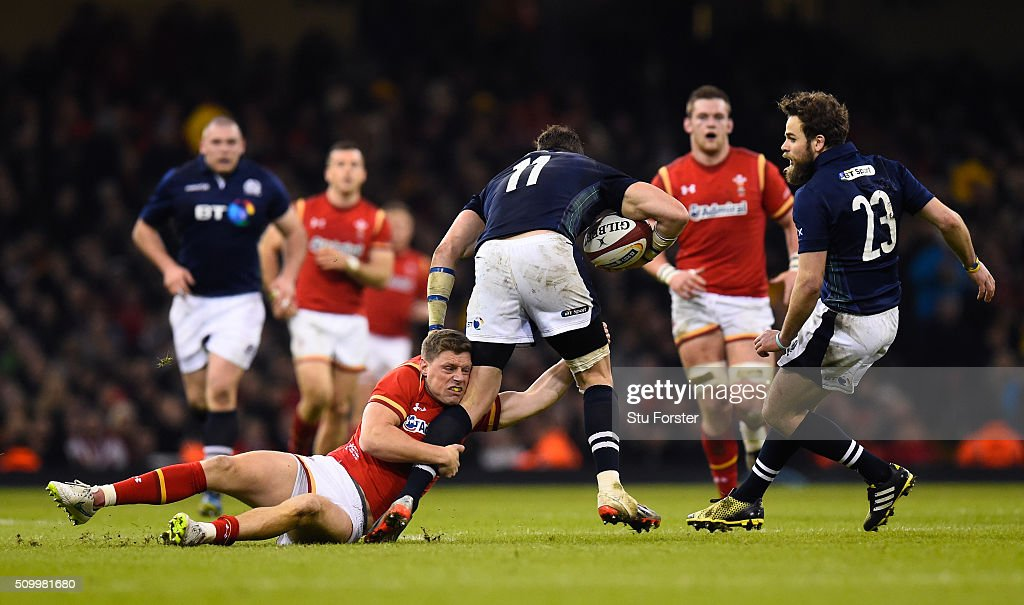 <a gi-track='captionPersonalityLinkClicked' href=/galleries/search?phrase=Tommy+Seymour&family=editorial&specificpeople=8797212 ng-click='$event.stopPropagation()'>Tommy Seymour</a> of Scotland is tackled by <a gi-track='captionPersonalityLinkClicked' href=/galleries/search?phrase=Rhys+Priestland&family=editorial&specificpeople=4195648 ng-click='$event.stopPropagation()'>Rhys Priestland</a> of Wales during the RBS Six Nations match between Wales and Scotland at the Principality Stadium on February 13, 2016 in Cardiff, Wales.