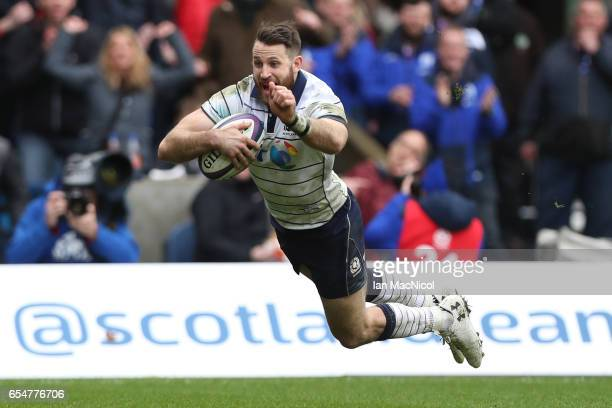 Tommy Seymour of Scotland scores his team's fourth try during the RBS Six Nations match between Scotland and Italy at Murrayfield Stadium on March 18...