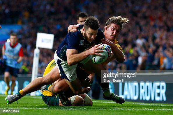 Tommy Seymour of Scotland scores his teams second try tackled by Michael Hooper of Australia during the 2015 Rugby World Cup Quarter Final match...
