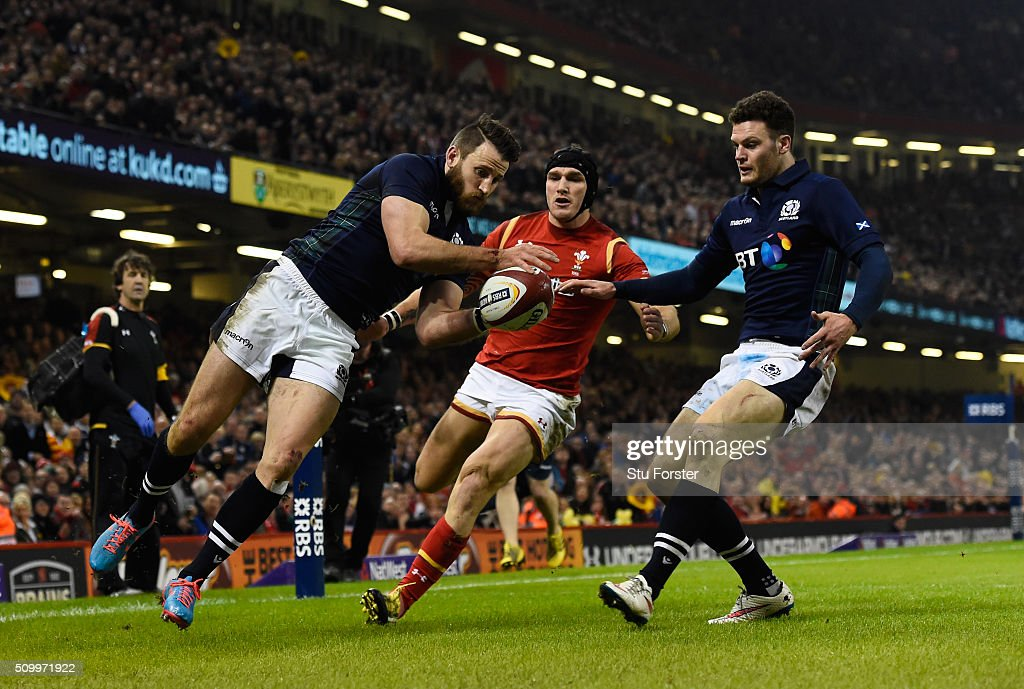 <a gi-track='captionPersonalityLinkClicked' href=/galleries/search?phrase=Tommy+Seymour&family=editorial&specificpeople=8797212 ng-click='$event.stopPropagation()'>Tommy Seymour</a> of Scotland takes a cross kick to score his team's first try during the RBS Six Nations match between Wales and Scotland at the Principality Stadium on February 13, 2016 in Cardiff, Wales.