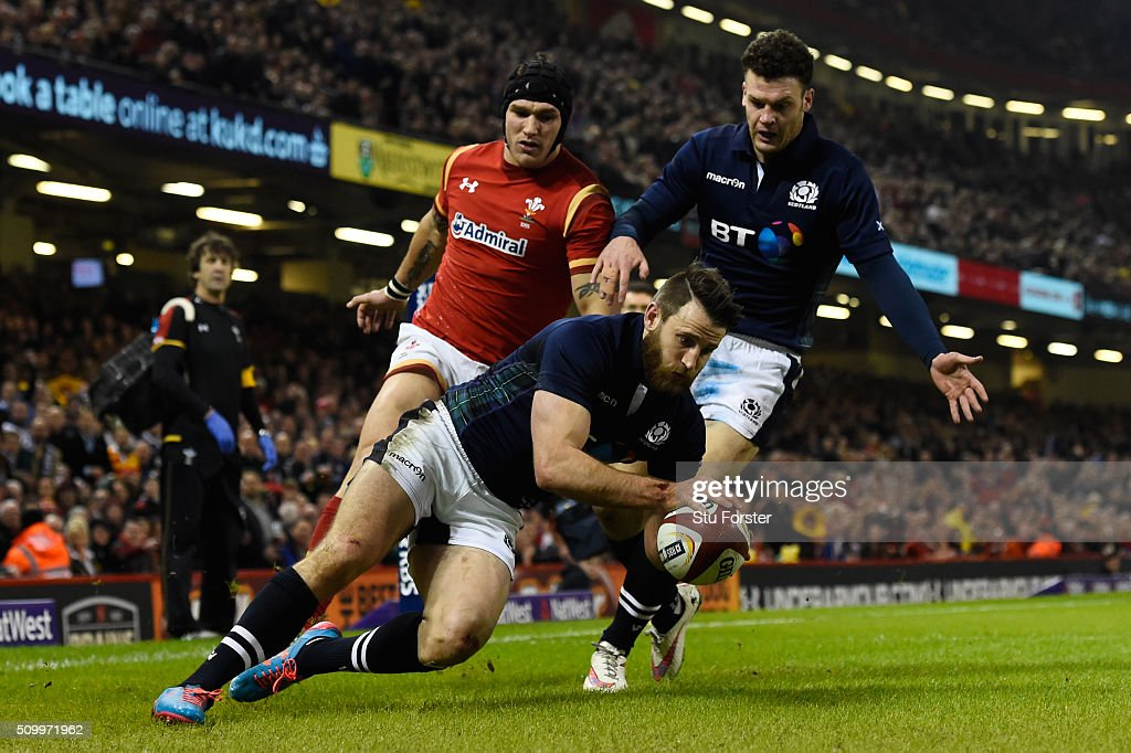 <a gi-track='captionPersonalityLinkClicked' href=/galleries/search?phrase=Tommy+Seymour&family=editorial&specificpeople=8797212 ng-click='$event.stopPropagation()'>Tommy Seymour</a> of Scotland touches down from a cross kick to score his team's first try during the RBS Six Nations match between Wales and Scotland at the Principality Stadium on February 13, 2016 in Cardiff, Wales.