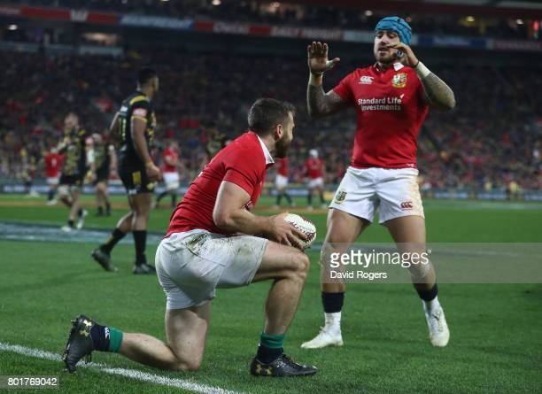 Tommy Seymour of the Lions is congratulated by teammate Jack Nowell of the Lions after scoring his team's third try during the 2017 British Irish...