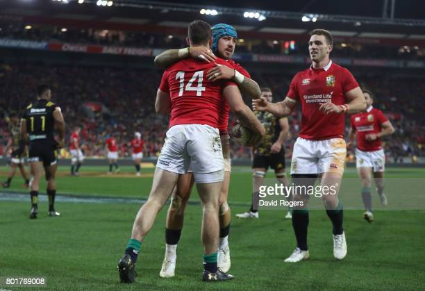 Tommy Seymour of the Lions is congratulated by teammates Jack Nowell and George North of the Lions after scoring his team's third try during the 2017...