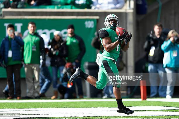 Tommy Shuler of the Marshall Thundering Herd makes a 26yard touchdown reception in the first half of the game against the Western Kentucky...