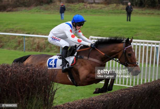 Tommy Silver ridden by Harry Cobden jumps the last fence in The John O'Gaunt Beginners' Chase at Leicester Racecourse