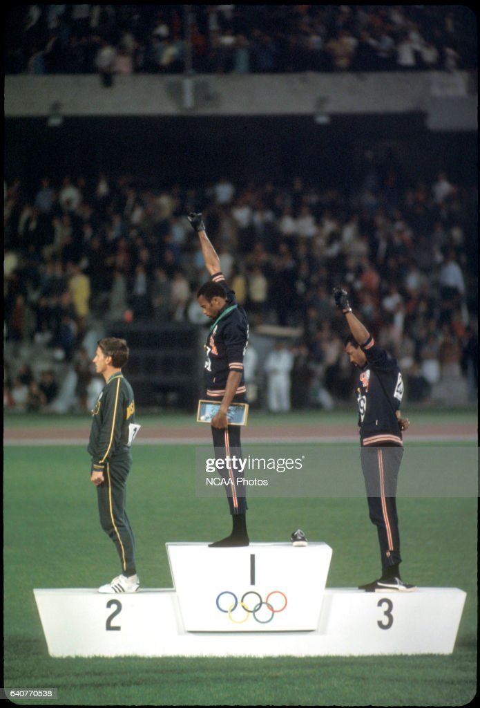 Tommy Smith (307) (1st place) and John Carlos (259) (3rd place) of the US raise their fists in the 'Black Power Salute' during the playing of the national anthem at the Olympics in Mexico City, Mexico...Photo: © Rich Clarkson / Rich Clarkson & Associates
