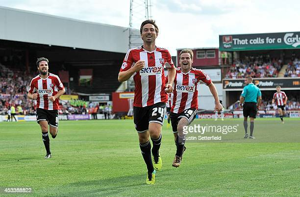 Tommy Smith of Brentford celebrates scoring Brentford's first goal during the Sky Bet Championship match between Brentford and Charlton Athletic at...