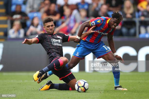 Tommy Smith of Huddersfield Town and Wilfried Zaha of Crystal Palace during the Premier League match between Crystal Palace and Huddersfield Town at...