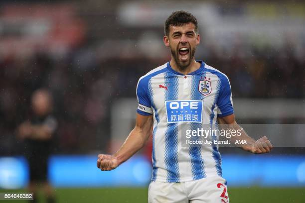 Tommy Smith of Huddersfield Town celebrates at full time during the Premier League match between Huddersfield Town and Manchester United at John...